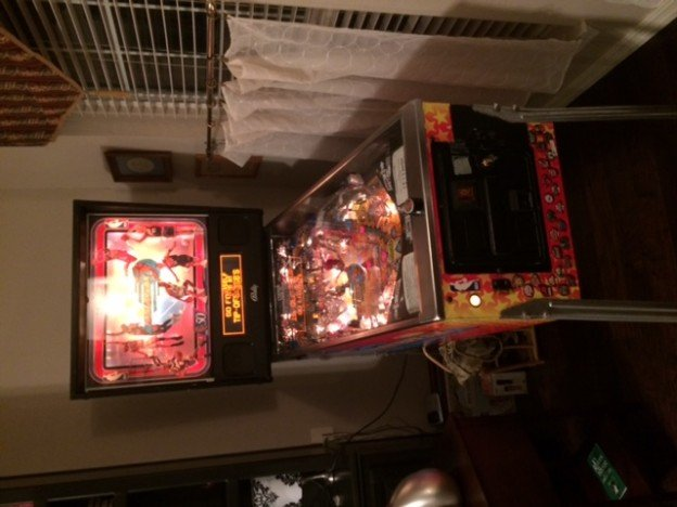 Backglass and coin door of NBA fastbreak pinball machine.