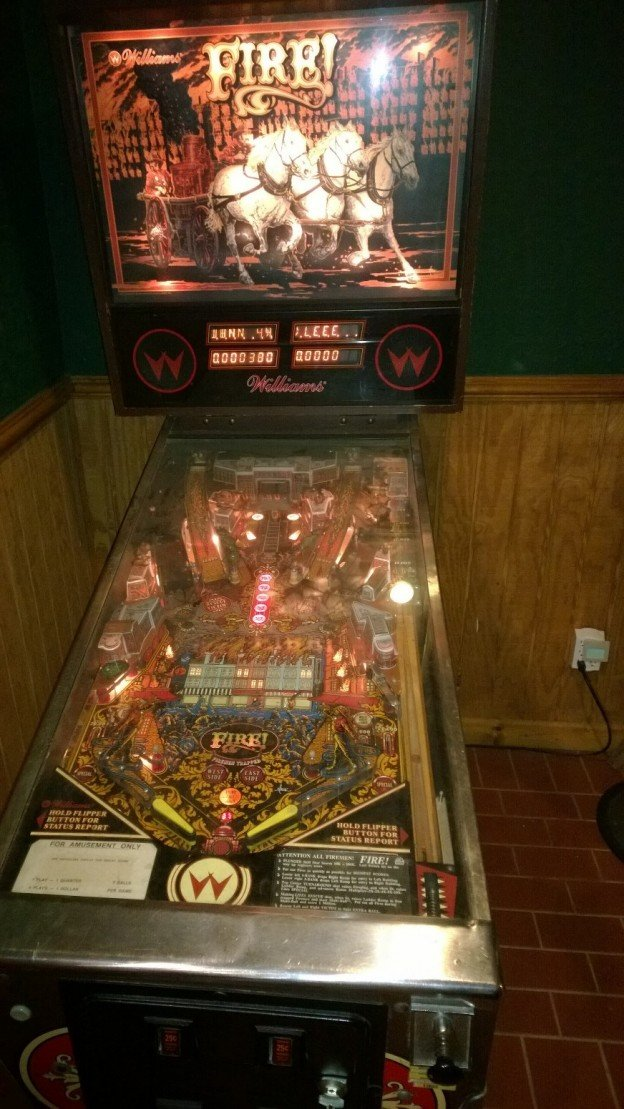 backglass and playfield of Fire! pinball machine for sale