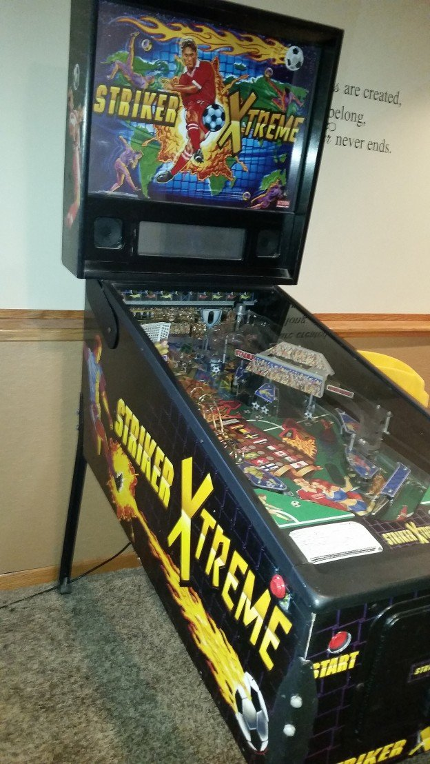 Side of Striker xtreme pinball machine for sale